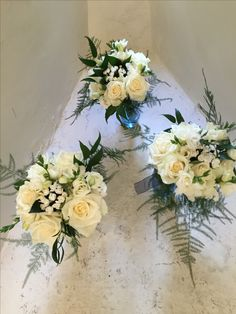 Bridesmaid's Bouquets of ivory Roses, Bouvardia and Freesia with deep green foliage Top Table decoration of ivory flowers and deep green foliage at Farnham Castle by Fiona Curry Flowers.