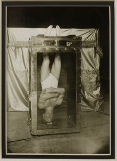 Houdini upside-down in the Water Torture Cell ,c.1912