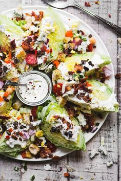 The Fully Loaded Wedge Salad is a salad even a salad hater can't resist with hearts of iceberg lettuce piled high with goodies like bacon eggs croutons black olives creamy blue cheese dressing and a few healthy veggies for good measure! Wedge Salad Recipes, Salad Recipes Video, Healthy Salad Recipes, Salad Bar, Soup And Salad, Cobb Salad, Eat Better, Clean Eating, Healthy Eating