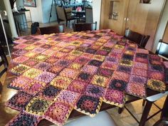 Made with Bernat Mosaic yarn. The yarn makes the color change for you, no canging colors. Neat!