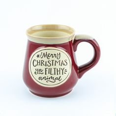 """Merry Christmas Ya Filthy Animal Ceramic Mug - A classic style ceramic mug with the words """"Merry CHRISTMAS ya FILTHY animal"""" on the front. It makes a great gift or addition to your own holiday collection."""