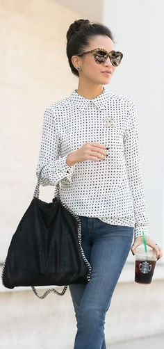 Polka dot silk blouse, black nails, big leo cat-eye shades. Love this look