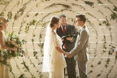 Ok, let's talk about this incredible ceremony backdrop for a sec! Ashley + Philip exchanged their vows in front of a beautiful spiral art piece consisting of different types of greenery pinned to a giant wooden board. So, so gorgeous and inventive! Love it.