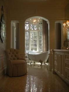 love the cream, the crown molding, the tub and girly lights.