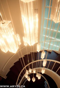 This spiral chandelier definitely raised the bar on this project with the beautiful custom spiral staircase below. Product provided by McLaren Lighting.
