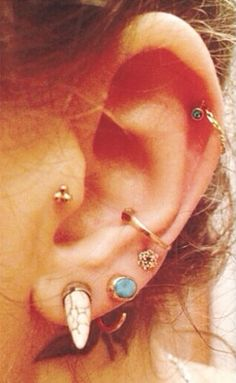 Tragus piercing, orbital piercing, helix piercing, and love piercing. #piercings #earpiercings