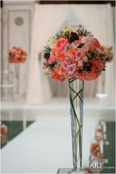 Beautiful bouquets along the aisle at Chicago Cultural Center