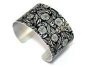 Wide aluminium Cuff bracelet, black with silver flowers Price £19.50