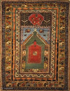 This Mudjur Meditation Prayer Rug has the richest palette of all Anatolian rugs, and resemble the very fine Caucasian rugs. Patterns and motifs are strictly geometrical. 4'2 x 6'1