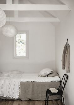 A guest bedroom in neutrals in an island retreat on the Swedish island of Gotland. Fantastic Frank.