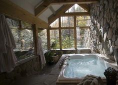 Love the rock in this cabin....oh and the tub too!