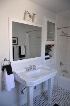 Hall Bath - Marble Basket Weave Tile Floor - Heavy Cast Iron Porcelain Kohler Tub with Shower and a Very large Built in Custom Cabinet