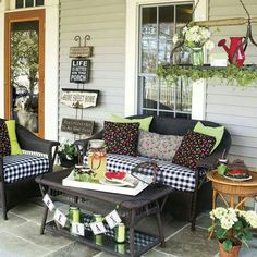 Create a recurring theme throughout your porch seating area by picking a summer icon and working it into your decor. Here, cheery cherry-covered pillows look perfect on the black-and-white checked cushions and infuse the area with their sweet style. Back Porches, Decks And Porches, Country Porches, Country Porch Decor, Southern Porches, Outdoor Rooms, Outdoor Furniture Sets, Outdoor Living, Veranda Design