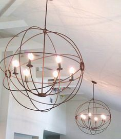 Ah to dream. Not in my budget, but love it. Orb hanging  orb Light Orb Chandelier  Orb by SealeFabrication, $600.00