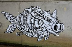 Stepping away from the square shaped psychedelic face paintings we are used to seeing, Paris street artist, Nosbe, painted these unique creature creations likely not existing in the animal kingdom.
