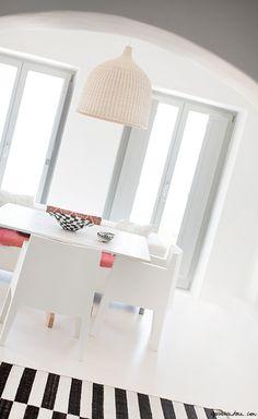 White walls, black and white stripe floor, windows, Mykonos / Garance Doré