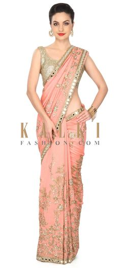 Buy this Peach saree adorn in floral and paisley motif embroidery only on Kalki