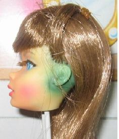 Is it possible to remove the green stain caused by earrings? I have a blonde bubble cut Barbie with pearl earrings. Both ears are really discolored.