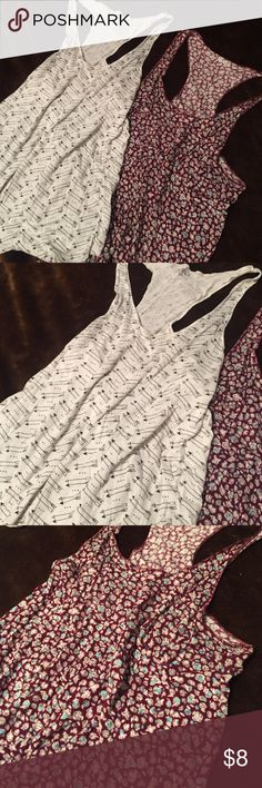 Razor back tank bundle Never worn tanks. I bought them with out trying them on and unfortunately too small for me. I would say they are more like a medium. Super soft and slinky. 100% rayon for both Mudd Tops Tank Tops