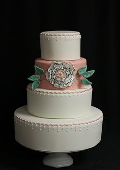 White salmon wedding cake with black scroll flower by Amanda Oakleaf Cakes, via Flickr