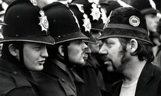 Face off between an NUM picket and lines of police, who have removed their…