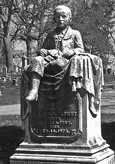 Green Lawn Cemetery, Columbus.George Blount, who died from a fall in his father's hotel. Nearly life-size statue.  People still bring flowers and gifts to his grave.