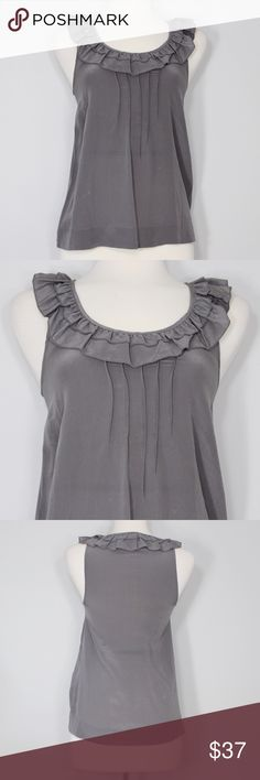 Silence + Noise (UO) Gray Ruffle Top Bust: tba (laying flat) Length: tba (shoulder to hem)  A fun addition to any wardrobe! Featuring ruffle details and a fabric with a beautiful sheen. In great condition! Dress up or down for work or casual wear. No holes, stains or imperfections.  📦Bundles welcome. ❌NO trades, please. ⚡️Same/Next day shipping Urban Outfitters Tops