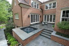 Lake Forest, IL Spa with brick walls and stone patio - traditional - patio - chicago - North Shore Hardscapes