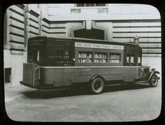 Book truck at 40th street entrance of New York Public Library's Central building, ca. 1930s