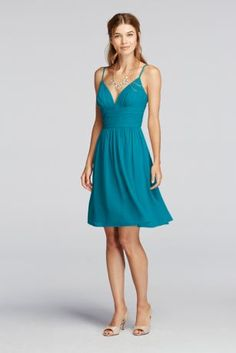This delightful short chiffon bridesmaid dress has a uniquely curved deep V-neckline and delicate spaghetti straps.   A ruched bodice combined with a flowing skirt  will compliment your figure.  Fully lined. Back zip. Imported polyester. Dry clean only.  Also available in Extra Length sizes as Style 2XLF19209.  To protect your dress, try our Non Woven Garment Bag.