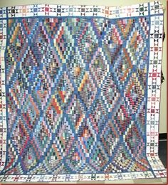 Bonnie's quilt pattern done by Jan C | I love the look of the blue for the main color on the diagonal.