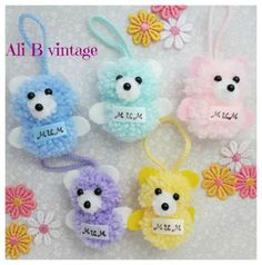 Mum pompom teddy bear teddy hanging decoration, this teddy decoration is available in five colour choices. Blue, mint. pink, lilac, or lemon Each teddy measures approximately 6cm tall, 6cm wide. with a 5cm hanger attached on the front of each teddy is a satin ribbon which says Mum. As these are made to order I can add other names but cannot be more than 6 letters (please let me know on checkout)  These teddies are also available on another listing without wording.