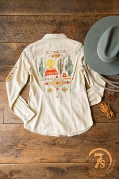 The Taos - Gorgeous southwest embroidered western shirt. Soft earth tone southwest embroidered details. Embroidered southwest pattern on front yokes, sleeves and full scene on back. Soft sand colored long sleeve shirt. Triple stitched contrasting stitching. Tortoise shell snaps. Double breast pockets. Flattering tapered fit.