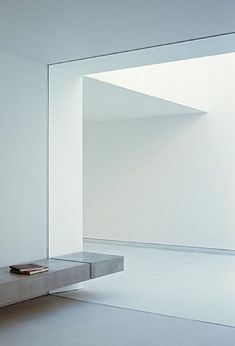 the White Cave House by Takuro Yamamoto Architects - clean lines, conctre bench and natural light.: