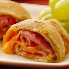 Ham and Cheese Crescent Roll-Ups - WIN! Very easy, very good, but not much of a meal for my lumberjack-like fiance. Great snack though. Used black forest ham and sharp cheddar. Could use almost any combo of meat and cheese though. Ham Cheese Rolls, Ham And Cheese Roll Ups, Crescent Roll Recipes, Crescent Rolls, I Love Food, Good Food, Yummy Food, Tasty, Tostadas
