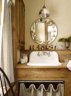 So charming! California ski house. Love the antique apothecary bottles and shaving brush collection. Design/ Kelly Abramson; Architecture/Robert Kelly.