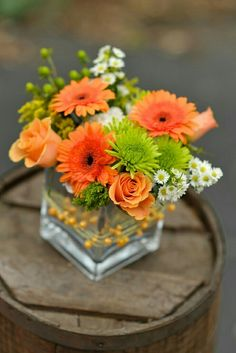 Dietz Floral Studio - Florist & Flower Delivery Service in Akron Ohio Centerpiece of peach roses, orange gerber daisies, green mums and white asters in silver cube wrapped in peach beaded wire Daisy Centerpieces, Centrepieces, Centerpiece Ideas, Flower Delivery Service, Gerber Daisies, Deco Floral, Table Flowers, Diy Flowers, Orange Flowers