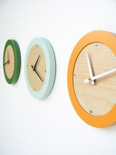 I'm loving these tangerine creamsicle modern wall clocks by uncommon on Etsy, $38.00