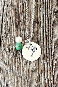 """Make a wish. Hope for the best. This necklace is .925 Sterling silver and measures approx. 5/8"""". It is adorned with a pearl and distressed turquoise glass on a 1.5 mm Sterling silver rolo chain."""