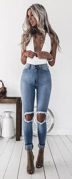 #winter #outfits /  White Top // Destroyed Skinny Jeans // Green Booties