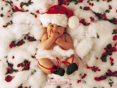 Cute idea adding the stuffing for snow look but minus the red and green jelly beans...instead red and green ornaments would be great! Cute baby christmas picture idea