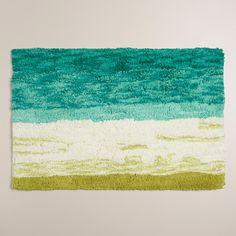 Soft underfoot, our tufted bath mat features an ombre design in shades aqua and green, lending a tranquil quality to your bathroom decor.
