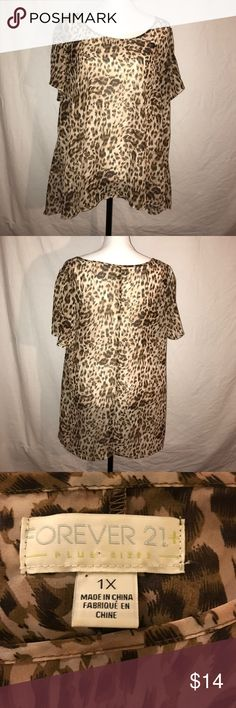Forever 21 Blouse, Size 1X This blouse is in good condition and has normals signs of wear.  It is a sheer blouse and is 100% polyester.  Also a hand wash only item.  Pit to pit is 23 Inches Length in front is 27 Inches Length in back is 29 1/2 inches Forever 21 Tops Blouses