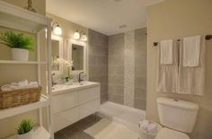 Contemporary 3/4 Bathroom with Corian counters, Ceramic Tile, Flush, Undermount Sink, Double sink, European Cabinets