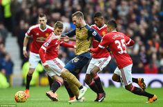 Aaron Ramsey is surrounded by Manchester United trio Guillermo Varela, Rashford and Jesse Lingard early on in the first half
