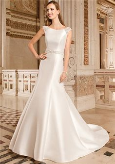 Chic, sleeveless mikado modified a-line gown with boat neckline features clusters of sparkling beading on shoulders that flow into plunging low back. Waist is finished with beaded trim and bow on back.