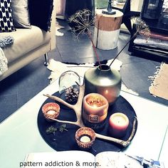 in February, living room table with black tray and candles