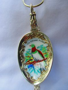 NZ native Wood Pigeon closeup - vintage and rare enameled spoon necklace with threepence and shilling jewellery - SS chain  www.bornwithasilverspoon.co.nz
