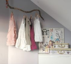 Master Closet Idea - Hang branches from the ceiling by chains instead of buying expensive closet bars - could hang a second row directly below by attaching chains to the first row.