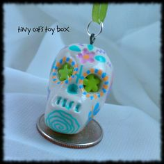 Hand painted, polymer clay Sugar Skull charm.   Dia de los Muertos.   Day of the Dead.    http://www.etsy.com/shop/TinyCatsToyBox